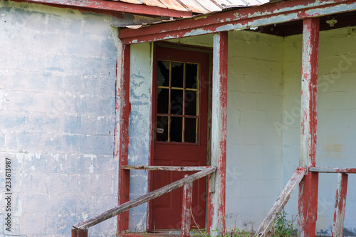 Photo  Abandoned Building Crimson and White, Concrete and Wood - Paint Frayed - Red Doo