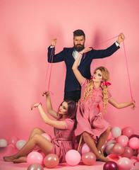 Obraz na płótnie Canvas retro girls and master in party balloons. Creative idea. Love triangle. Crazy girls and man on pink. Halloween. vintage fashion women puppet and man. holidays and dolls. dominance and dependence