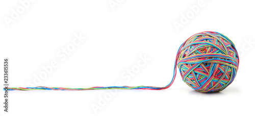 Photo  Colorful cotton big thread ball from four color thread isolated on white background