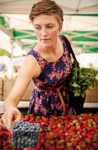 Woman Carrying Chard Buying Strawberries At Market