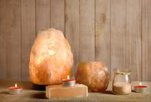 Himalayan Salt Soap Bar, Pink Rock Salt Lamp Turned On And Salt Candle Holder, With Candle Burning Inside, Jar With Salt Grains On Wooden Natural Background, Studio. Calming Zen Moods Concept.
