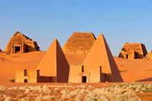 Pyramids In Desert Against Sky