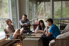 Family Playing Backgammon Game At Home