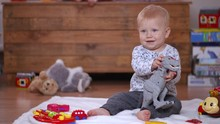 Infant Child Sitting And Playi...
