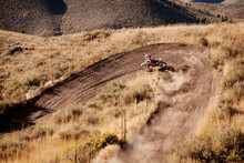 High Angle View Of Man Riding Motorcycle On Dirt Road