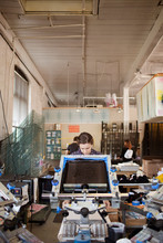 Woman Operating Printing Machinery In Factory