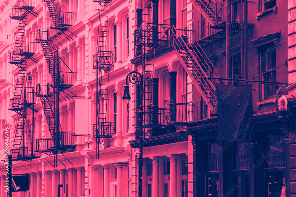 Fototapety, obrazy: Buildings in SoHo New York City with pink and blue color overlay