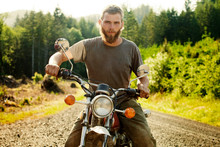 Portrait Of Confident Man Sitting On Motorcycle