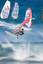 Friends Windsurfing In Sea