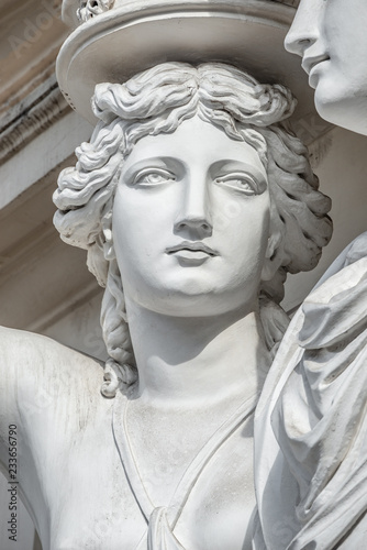 Foto auf Leinwand Historische denkmal Portrait of balcony support statue of young and naked sensual Roman renaissance era women in Vienna, Austria, details, closeup