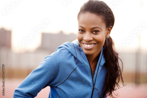 Portrait of confident smiling female athlete