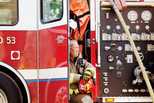 Fireman Sitting In Fire Engine