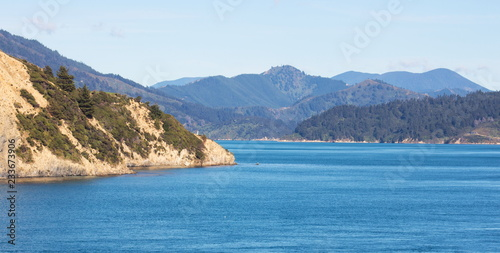 Landscape image of the sea and land that makes up the breath taking scenery of the Marlborough Sounds in New Zealand.