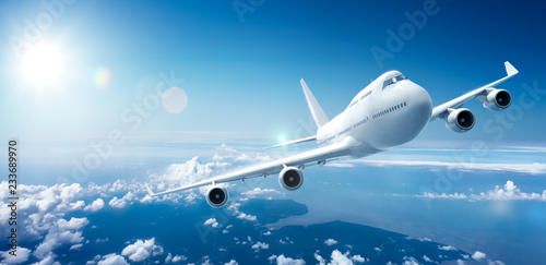 Fotografia, Obraz  Airplane flying above clouds