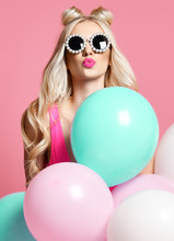 Trendy Cheerful Blonde Woman On Birthday Party Having Fun With Pastel Color Air Balloons  Blow Kiss
