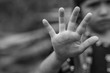 Violence, Abuse, Punishment,Child raised her hand for dissuade, campaign stop violence against child, black and white color