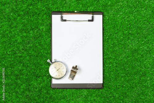 Sheet of paper and sports equipment on grass close-up Canvas Print