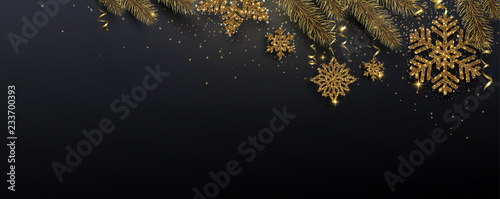 Fototapeta Black festive banner with fir branches and golden shiny snowflakes. obraz