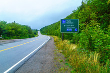 Landscape And Direction Sign Along The Cabot Trail