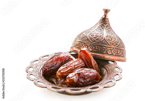 Valokuva  Plate of pitted dates isolated on a white background.