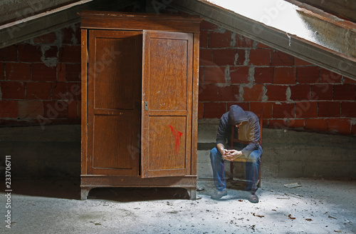tired man like a soul sitting on a chair in the attic Canvas Print