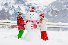 Child Building Snowman. Kids B...