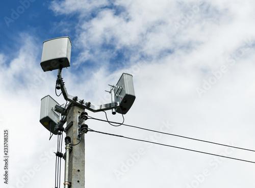 Small mobile antenna on concrete pole.