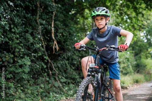 Aluminium Prints Cycling A young boy riding his bike