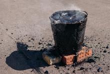 Molten Hot Tar In A Bucket On ...