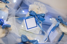 Wedding Favor Decorated With Lace And Blue Ribbon With Message In A Bottle With White Labels Ready To Personalize With Your Text