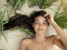 Free Happy Woman On The Beach Enjoying Nature Of Tropical Island. Natural Beauty Girl Outdoor. Enjoyment Of Summer Trip Concept. Gorgeous Mixed Race Caucasian Asian Girl Posing On Travel Vacation