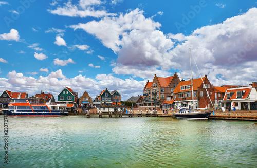 Volendam, Netherlands. High-speed motorboat by docks near old
