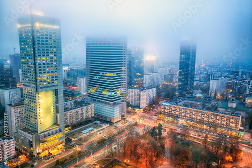 Autocollant pour porte Pékin WARSAW, POLAND - NOVEMBER 4, 2018: Modern skyscrapers in the downtown district of Warsaw, Poland. Aerial view during the foggy night.
