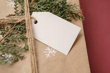 Blank Gift Tag On Classy Vintage Christmas Gift Box. Christmas Presents With Handmade Decoration. Close Up. Mockup. Copy Space.