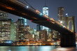 Lower Manhattan with Brooklyn bridge from across the Hudson river at night