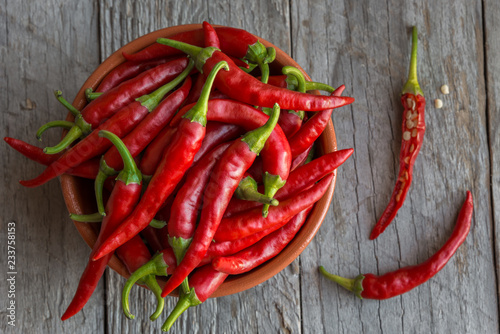Staande foto Hot chili peppers Hot chili peppers on wooden background