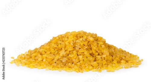 Fotografie, Obraz  Hill cereals bulgur wheat closeup on a white background.