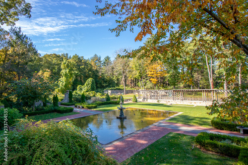 Fotografie, Obraz  view of small man made pond with statue and landscaped area