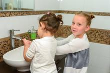 Two Little Girls In Bathroom W...