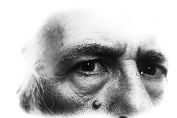 Backlit black and white image of man's eyes looking directly at viewer, grain visible at 100%