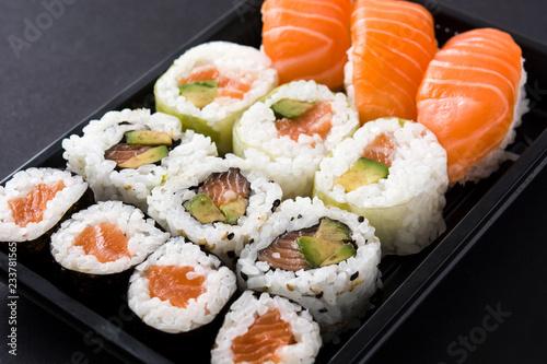 Poster Sushi bar sushi pack with nigiri and maki on black background