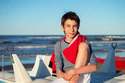 Young Boy Sitting On Catamaran At The Summer Beach Cute Spectacled