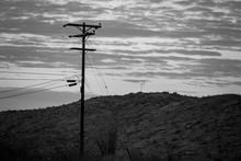 A Telephone Pole And A Cross O...