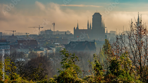 Foggy and cloudy cityscape of Gdansk with St. Mary's Basilica.