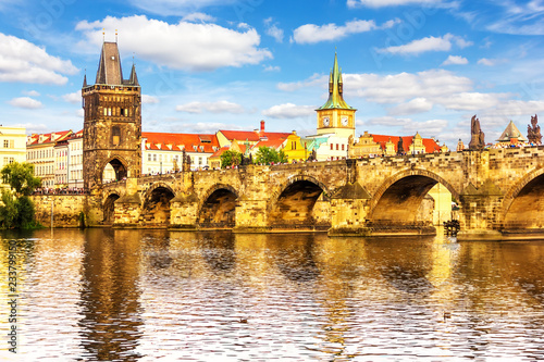 Charles Bridge and view the Tower of Lesser Town of Prague