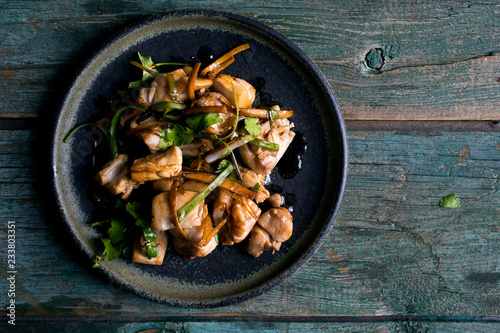 Close up of ginger soy sauce chicken served on plate