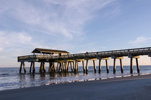 Tybee Island Pier In Southern Georgia United States On The Beach Of The Atlantic Ocean, Golden Hour