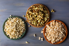 Variety Of Popcorn Served In Wicker Plate On Table