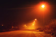 Night street view with nobody out there at evening mist with orange glow from the street lights. Braunschweig, Germany