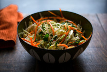 Close Up Of Vegetable Salad Served In Bowl On A Wooden Table